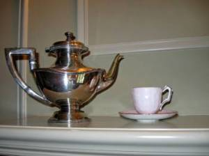 1920s silver teapot and cup and saucer on display at the Ainsley House in Campbell, CA.